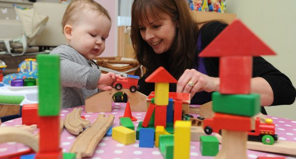sarah-steel-md-the-old-station-nursery-with-baby-and-blocks