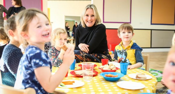Caroline Dinenage Minister for Early Years with children at The Old Station Nursery at The Oxford Science Park