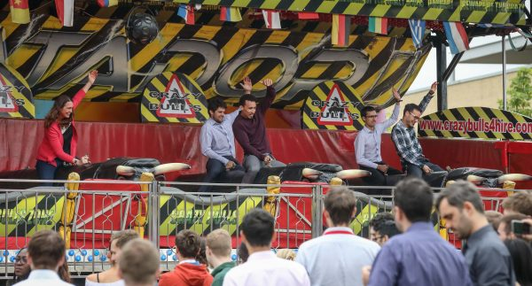 Extreme lunchbreak as more than 1,500 people from The Oxford Science Park enjoy the annual Summer Party including the fun fair and Crazy Bulls ride